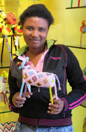 Mandisa Mvinjana posing with her beaded horse